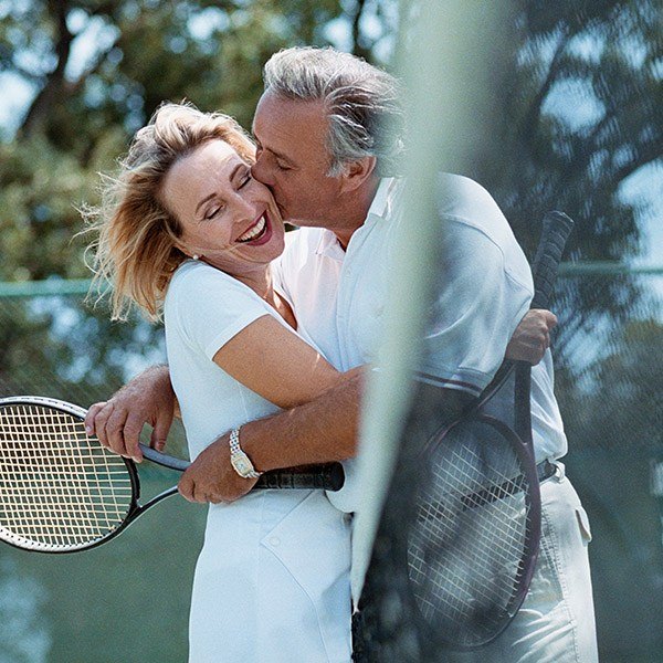 Couple with tennis rackets